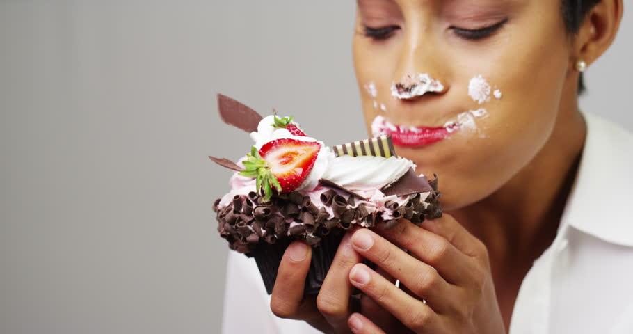 Black Woman Making A Cake